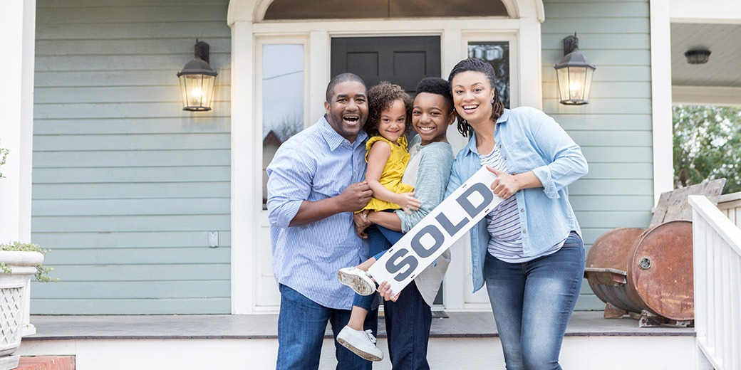 Family proud of their new home