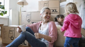 woman and children unpacking boxes