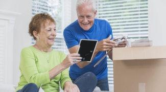 Senior couple packing a box