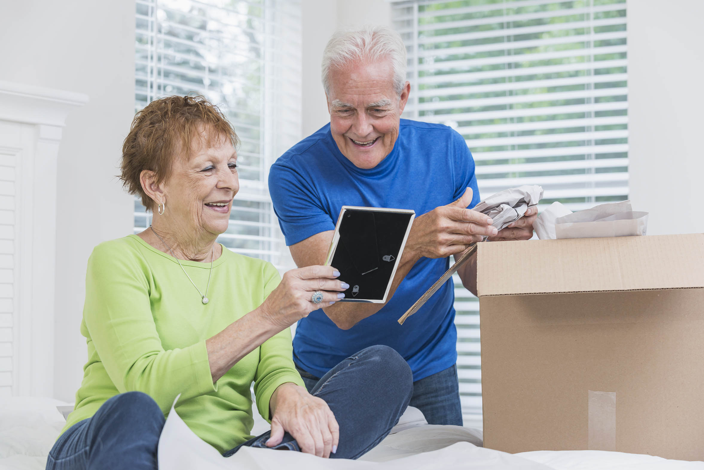 Senior couple packing a box