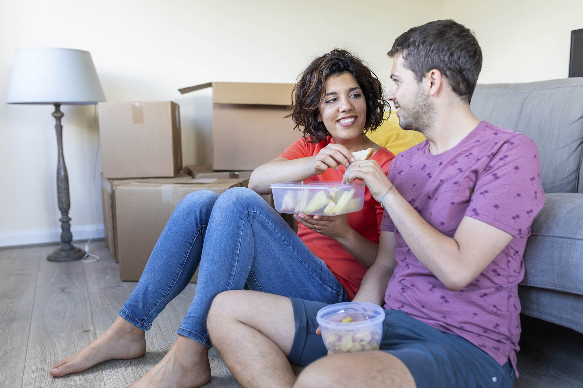 Couple moving into new home taking a break and having lunch
