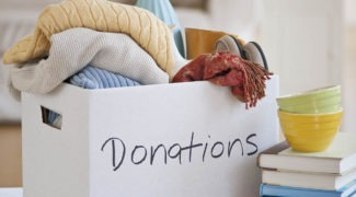 Box of clothes marked for donation