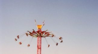 Swings at a fair. Enjoy summer activities in the Twin Cities.